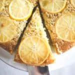 lemon olive oil cake on a white cake plate