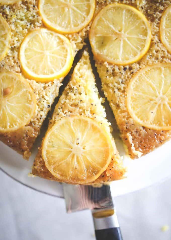 lemon cake on a white cake plate