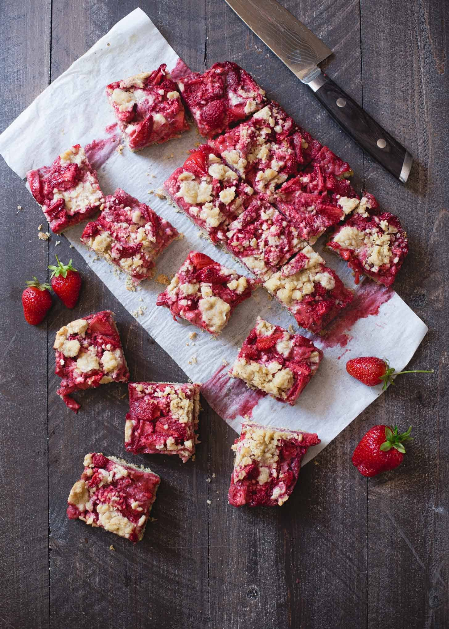Strawberry Oat Streusel Bars on a wooden table