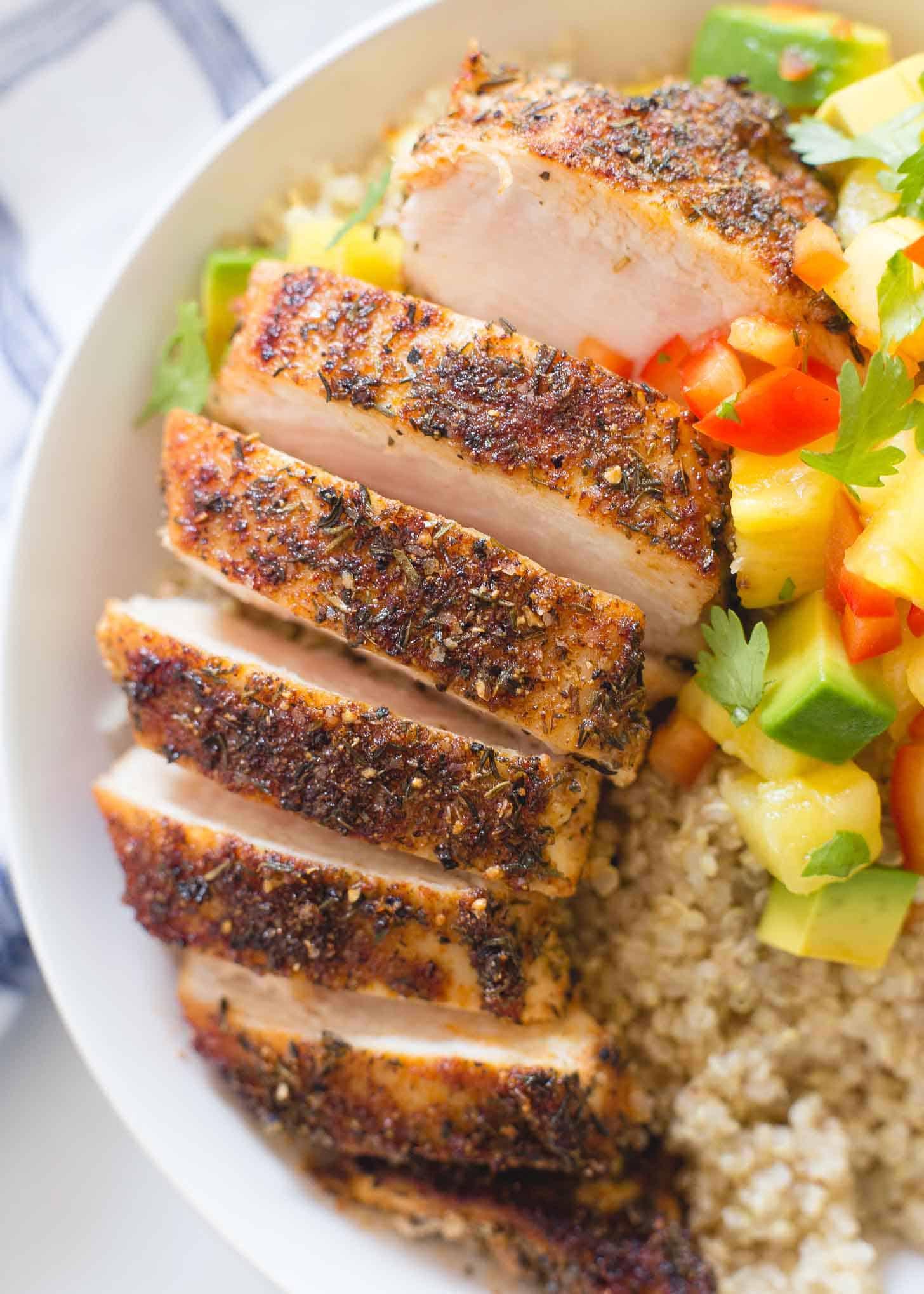 Caribbean Chicken sliced over a bowl of quinoa
