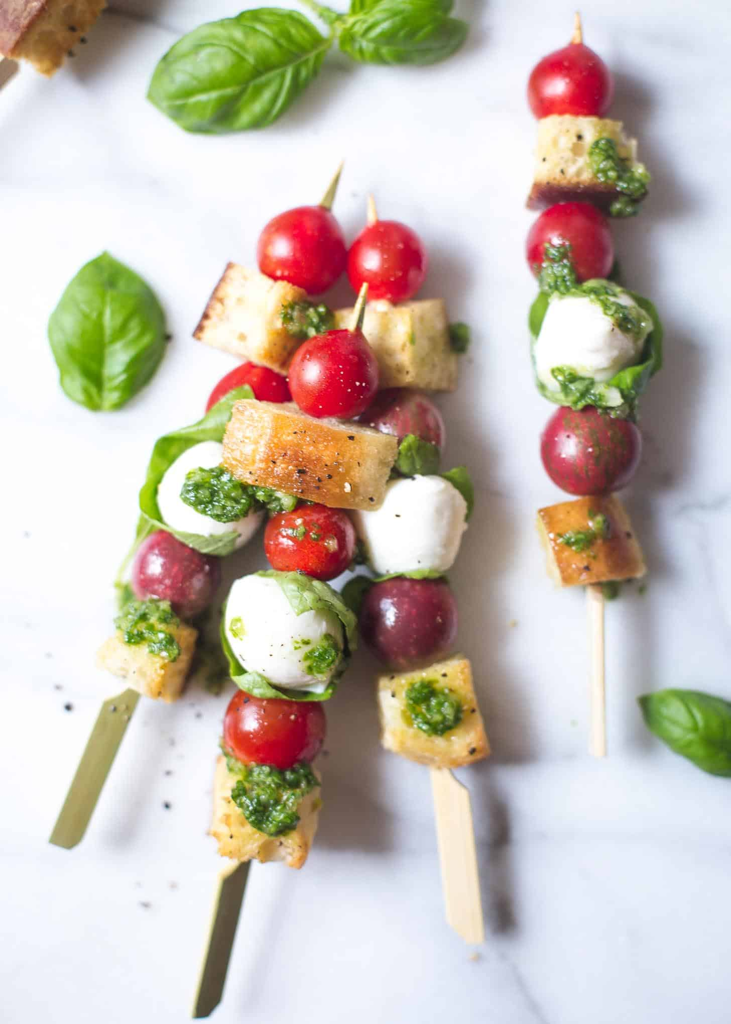 panzanella skewers on a white table
