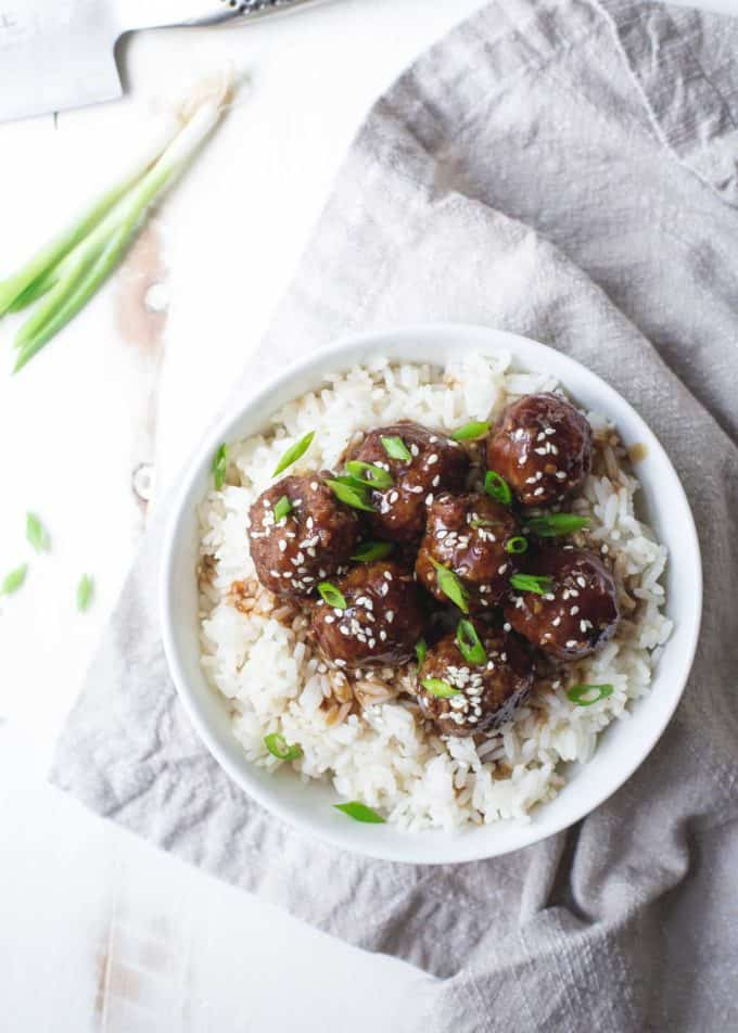 Hoisin Meatballs over rice in a white bowl
