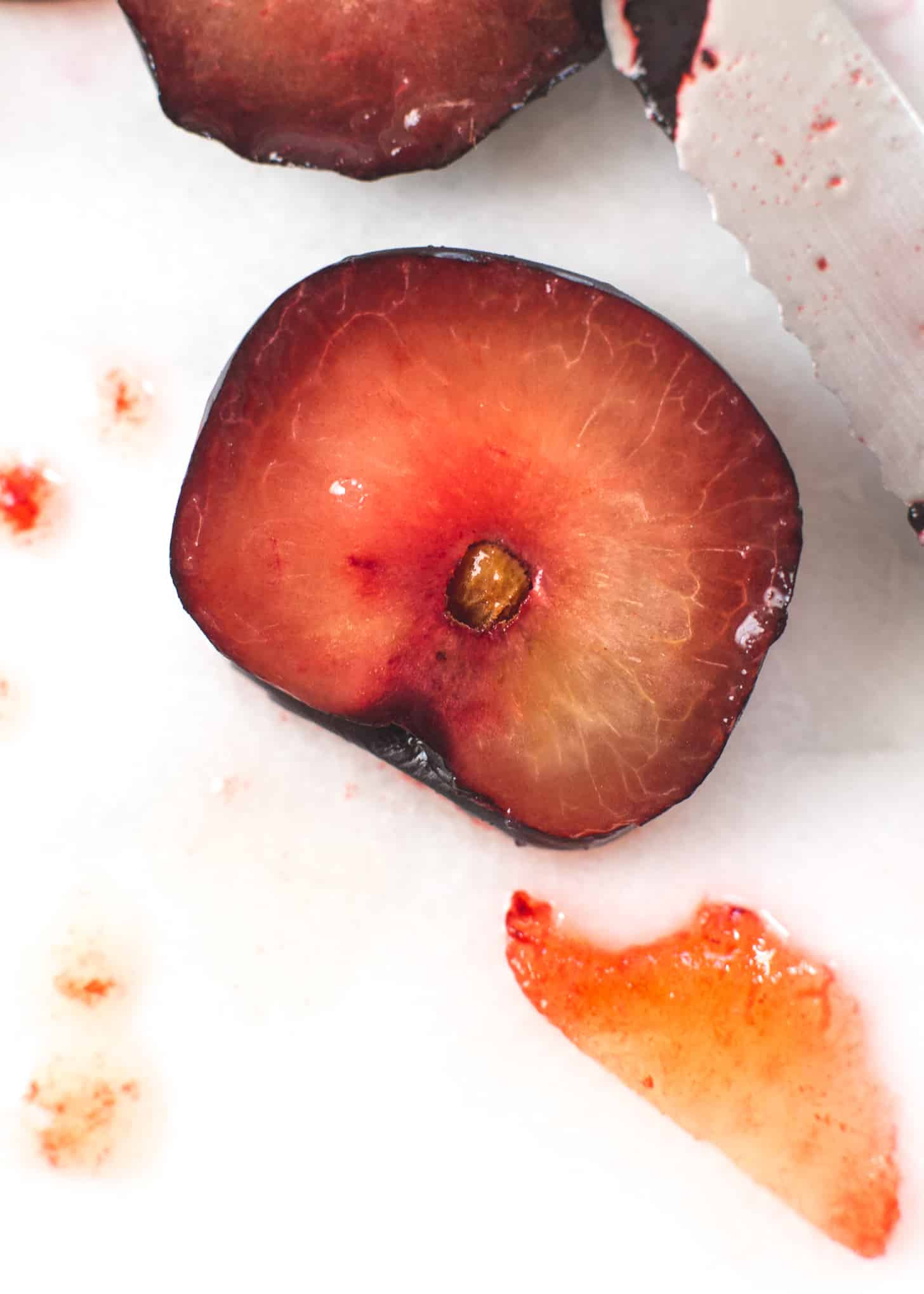 Plums on a white table
