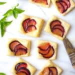 plum tarts on a white countertop