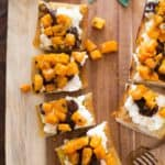 Butternut Squash Crostini on a wooden tray
