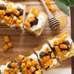 squash crostini on a wooden tray