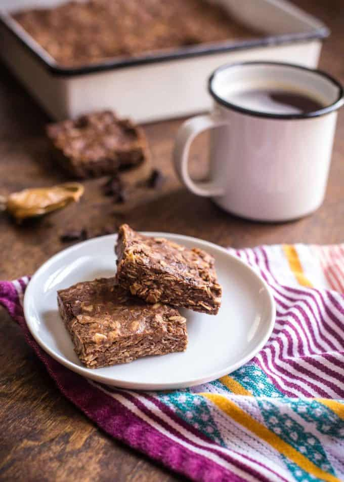 Chocolate Peanut Butter Oat Bars with a cup of coffee