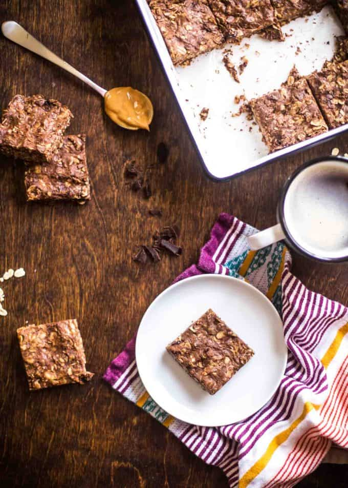 Chocolate Peanut Butter Oat Bars on a wooden table