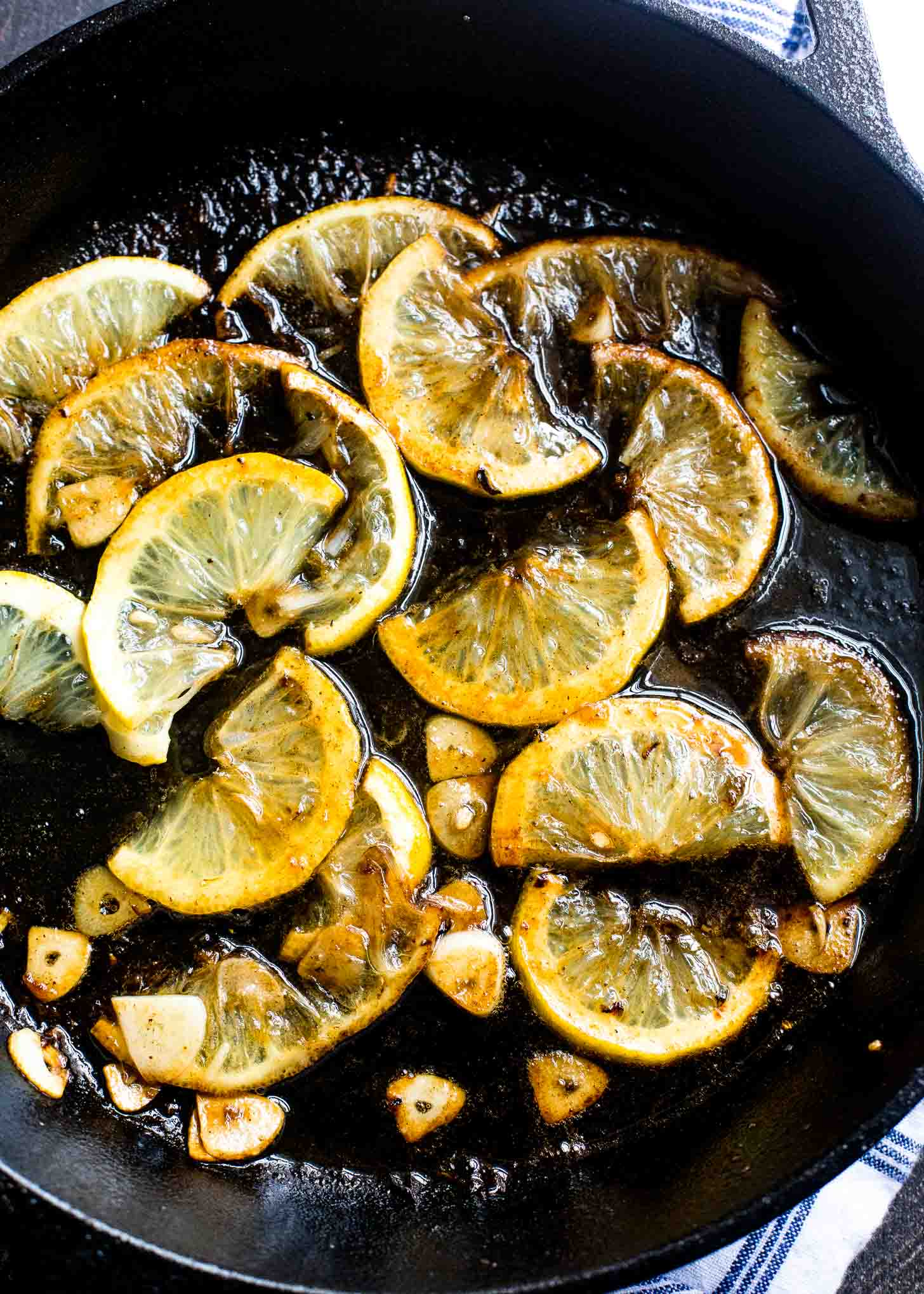 Charred Lemons in a cast iron skillet with sugar and garlic