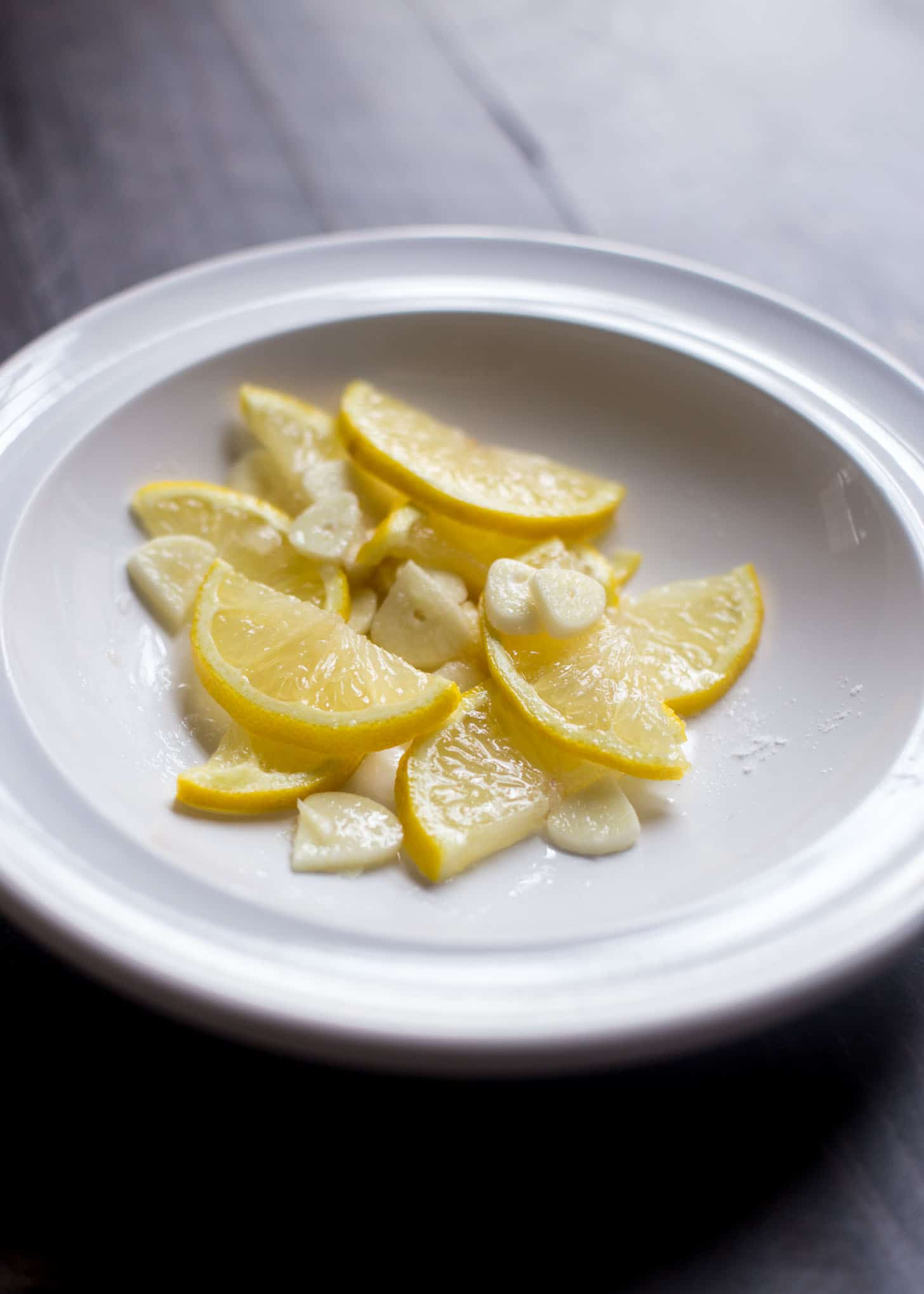 Charred Lemons in a white bowl