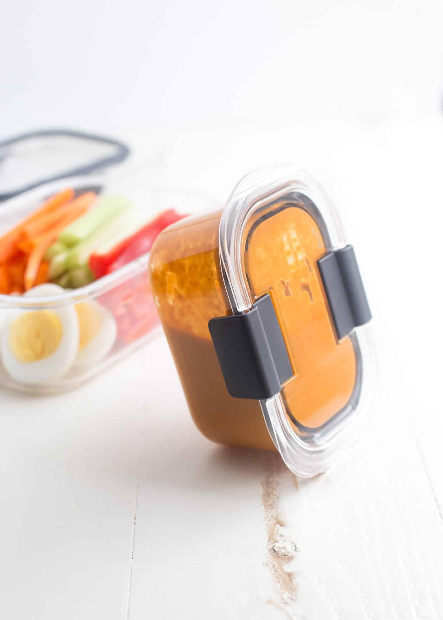 Thai peanut sauce in a plastic container