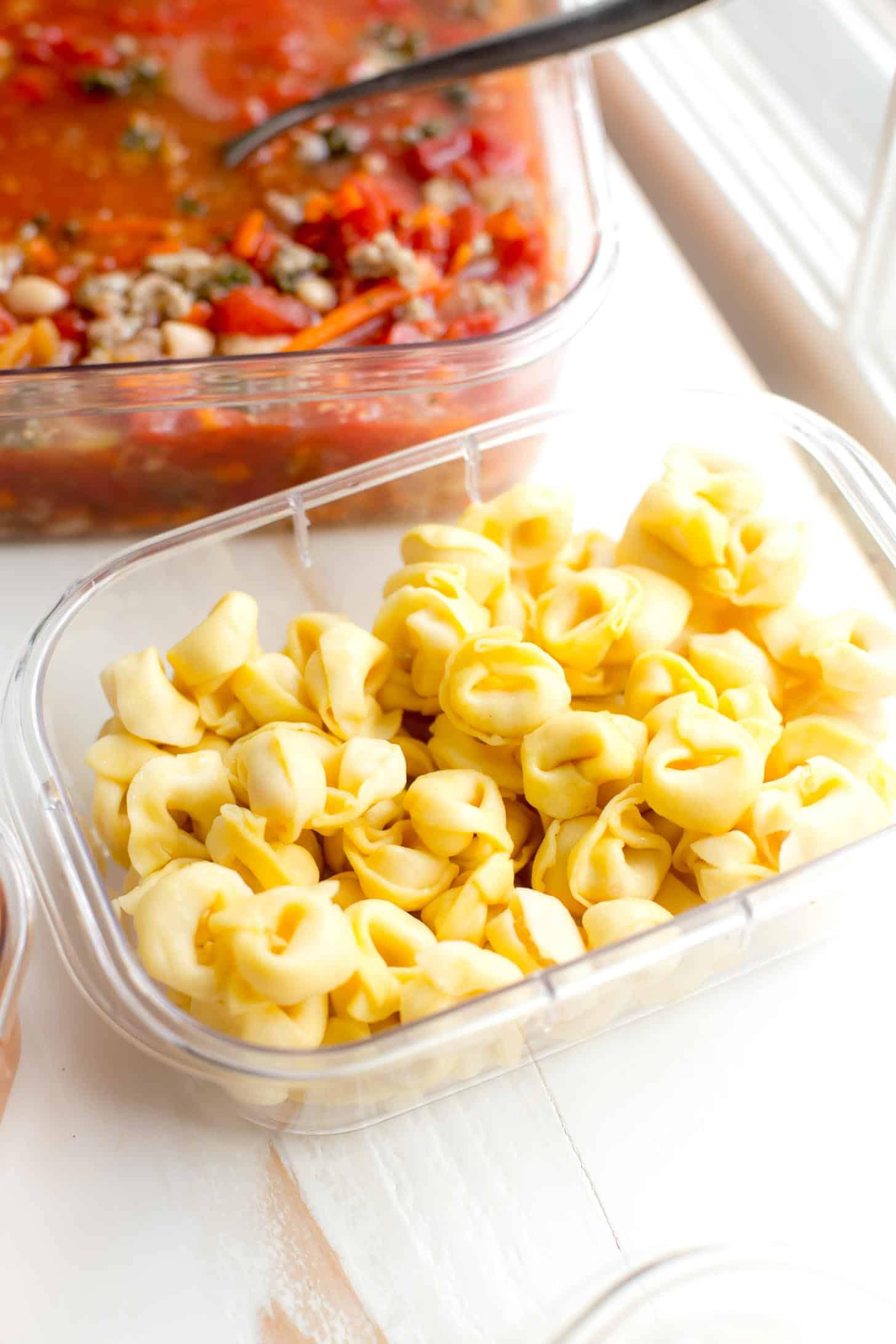 cooked tortellini in a plastic container