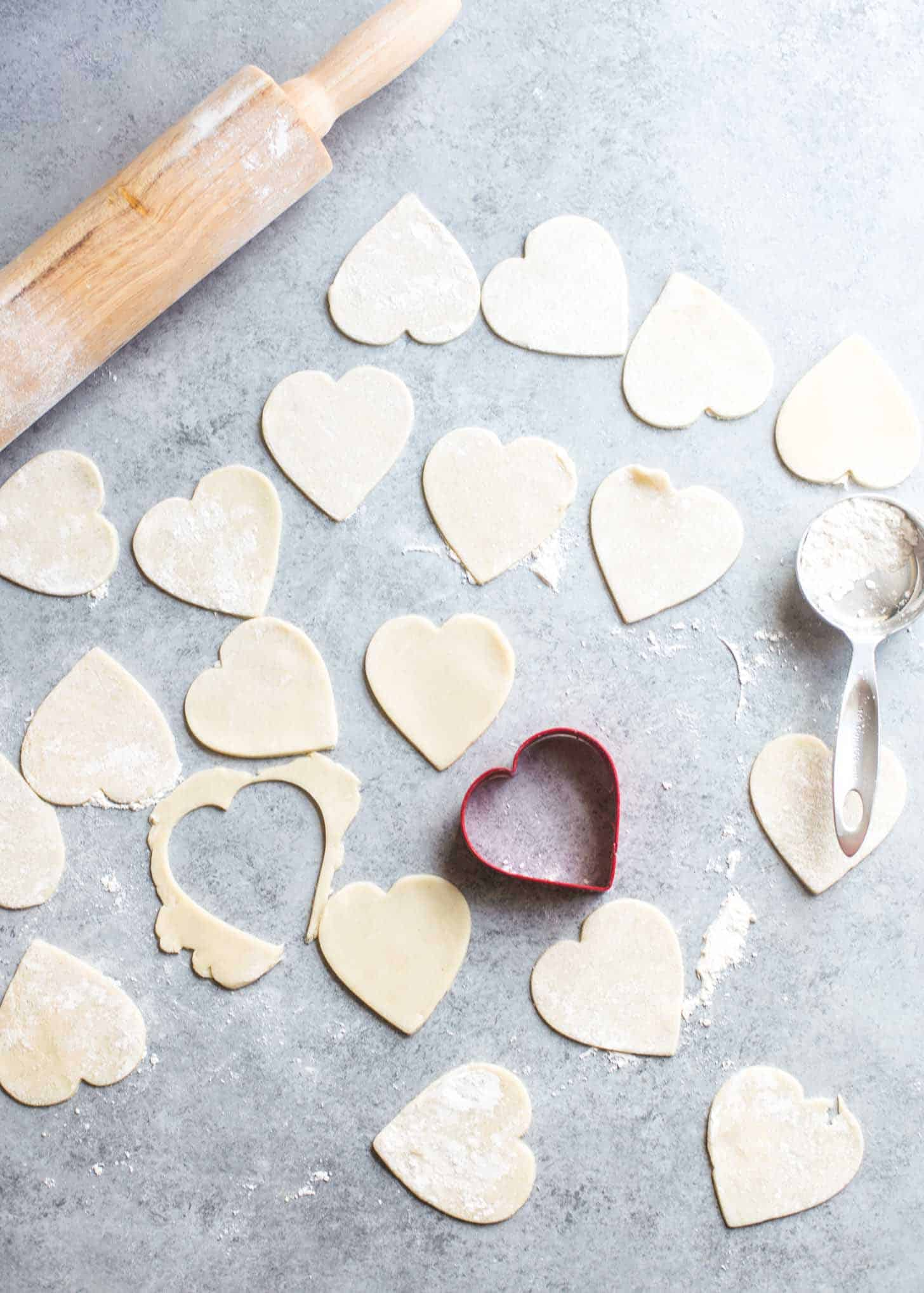 cutting out heart shapes from dough