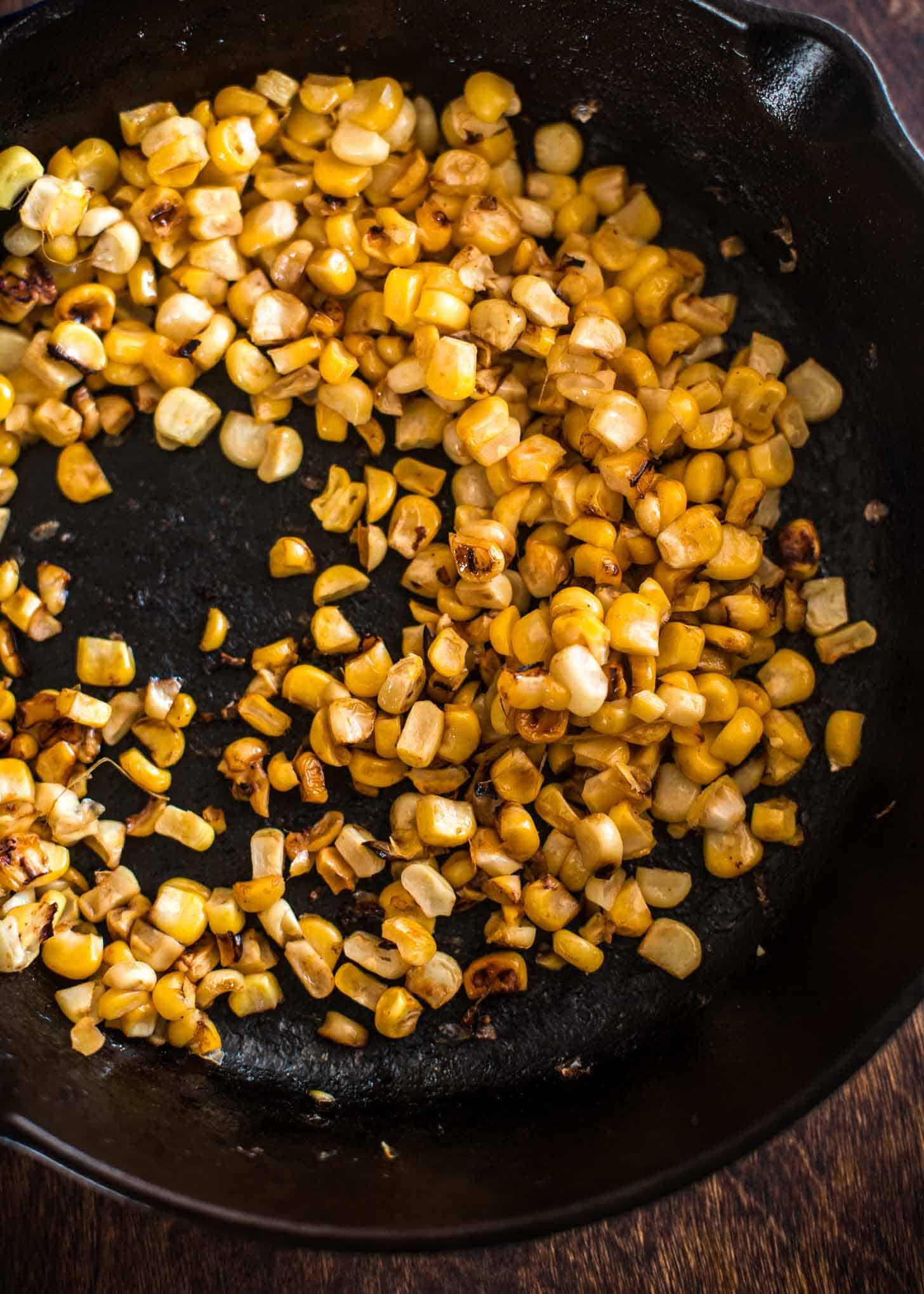 Charred Corn in a cast iron skillet
