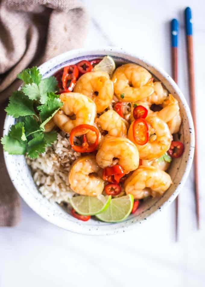 honey lime shrimp in a bowl over rice