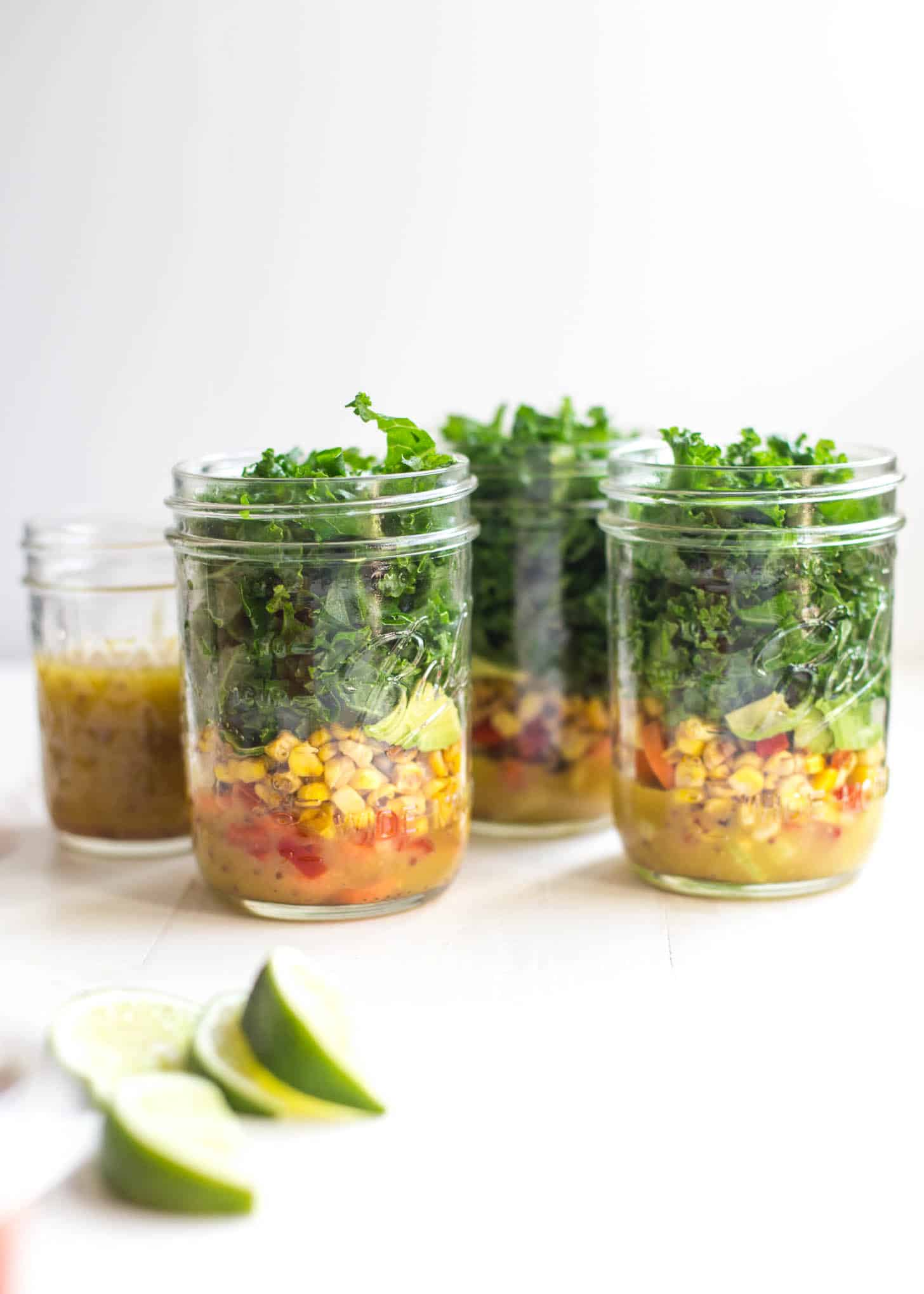 salads prepped in glass jars