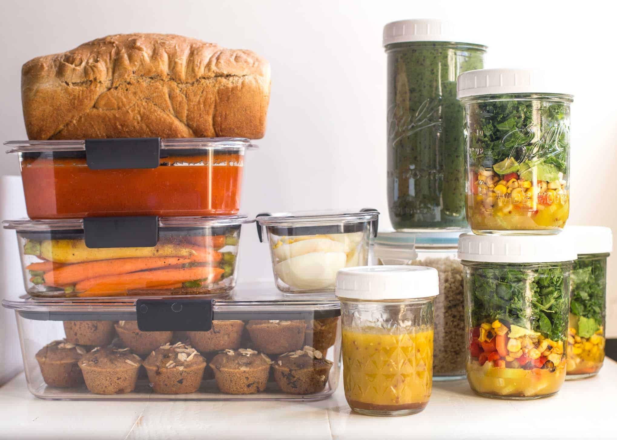 meals prepped in containers on a white table