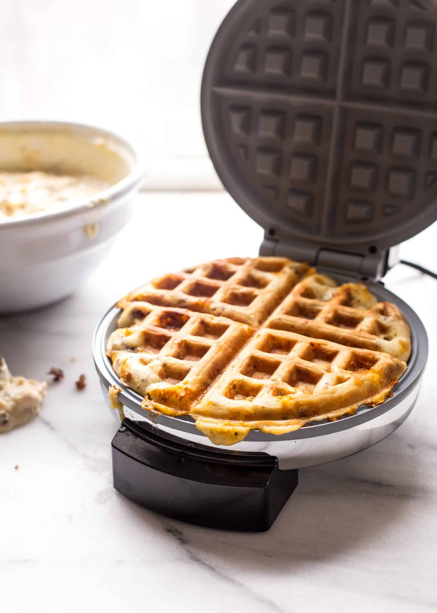 cooking savory waffles in a waffle maker
