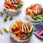 chicken fajita quinoa bowls on a white table
