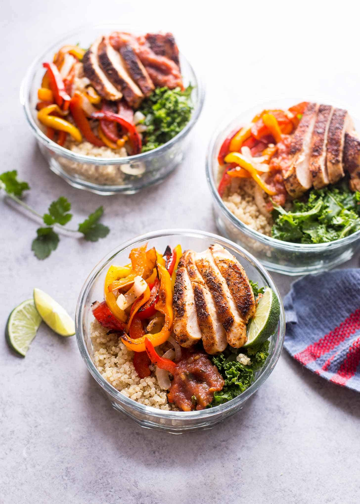 chicken fajita quinoa bowls on a white table