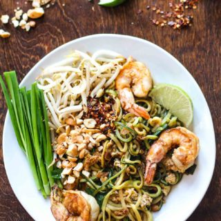 pad thai with zucchini noodles on a white plate