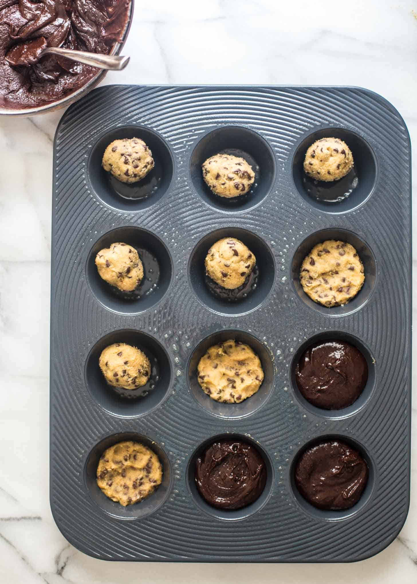 Thick and Chewy Chocolate Chip Cookie Brownies in a muffin tin