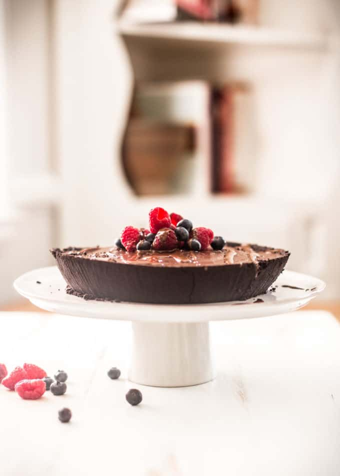 No Bake Double Chocolate Pie on a white dessert stand