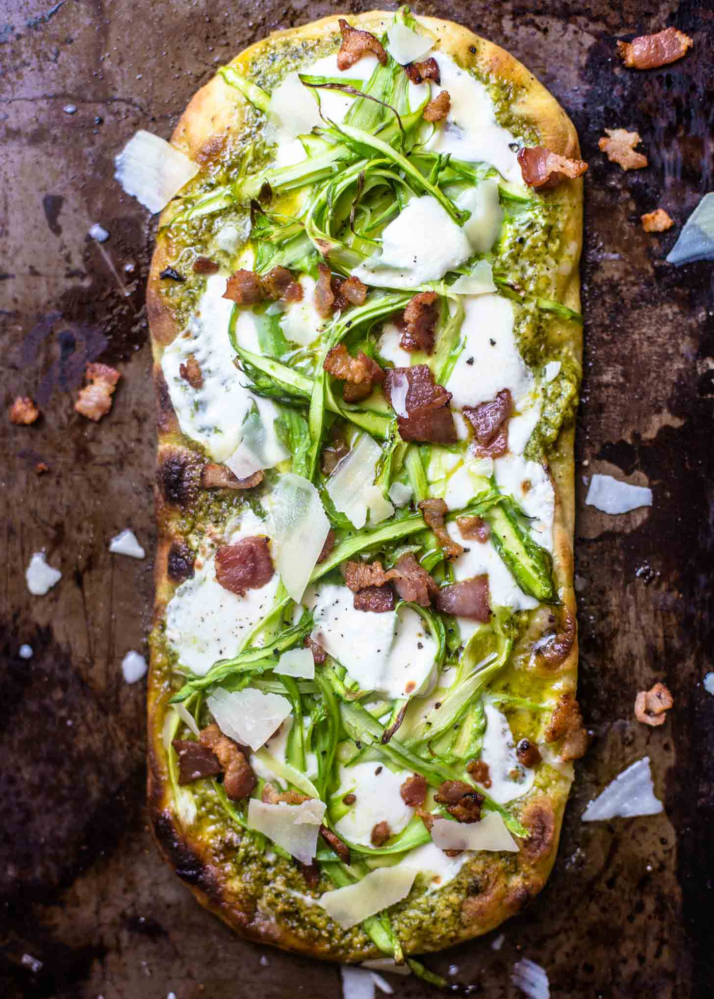 Pesto Flatbread with Shaved Asparagus and Bacon on a sheet pan