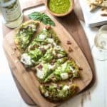 Pesto Flatbread with Shaved Asparagus and Bacon on a wooden tray