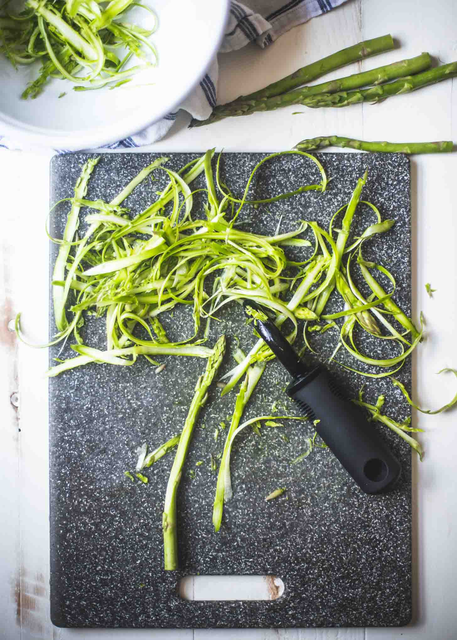 Shaved Asparagus on a cutting board