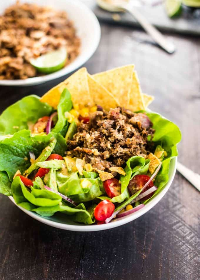 Slow Cooker Carnitas Taco Salad in a white bowl