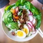 spring cobb salad in white bowl