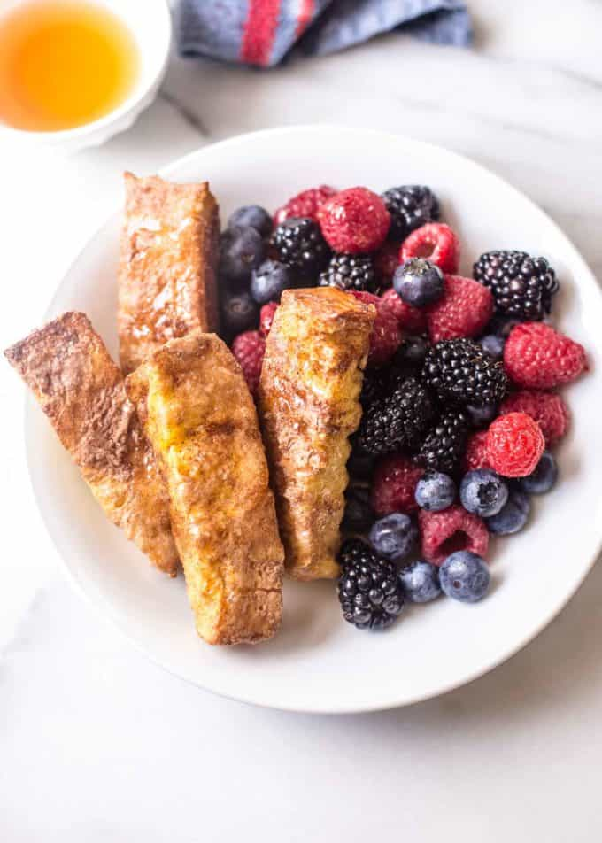 Baked Cinnamon French Toast Sticks in a white bowl