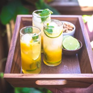 passion fruit mojitos on a tray outside