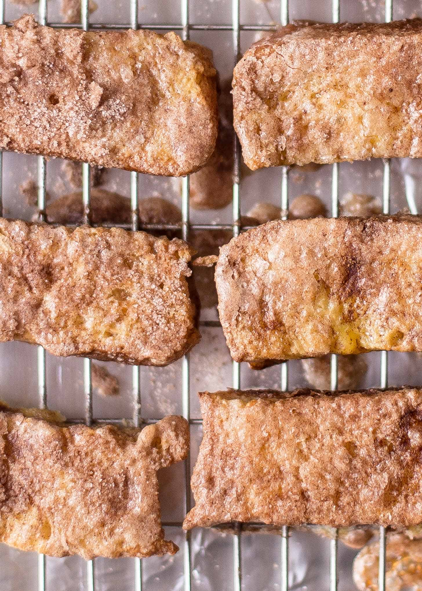 Baked Cinnamon French Toast Sticks on a cooling rack