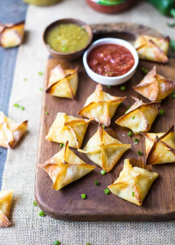 Baked Cheesy Chicken Wontons on a wooden tray