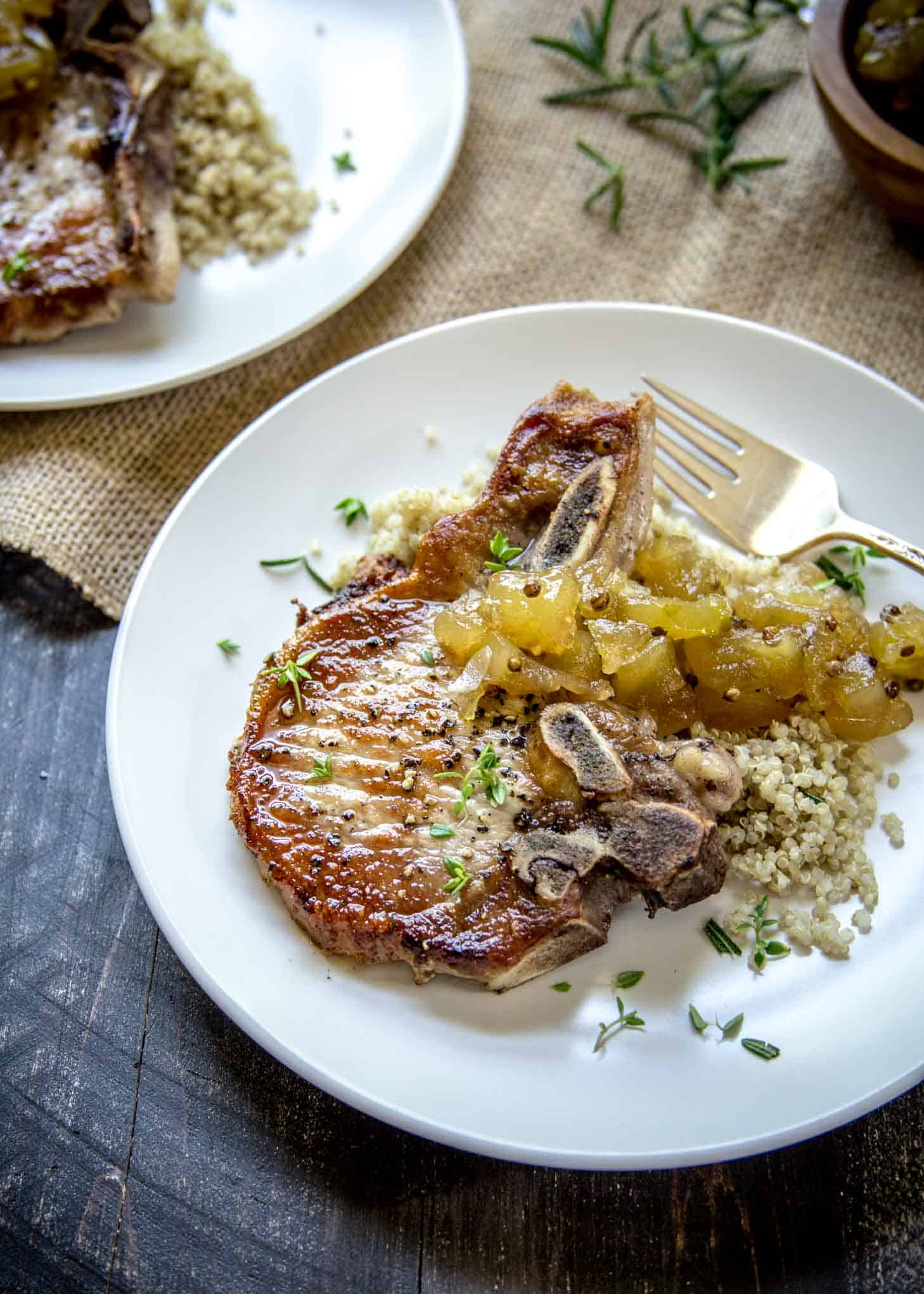 Herb Marinated Pork Chops with Apple Chutney on a white plate