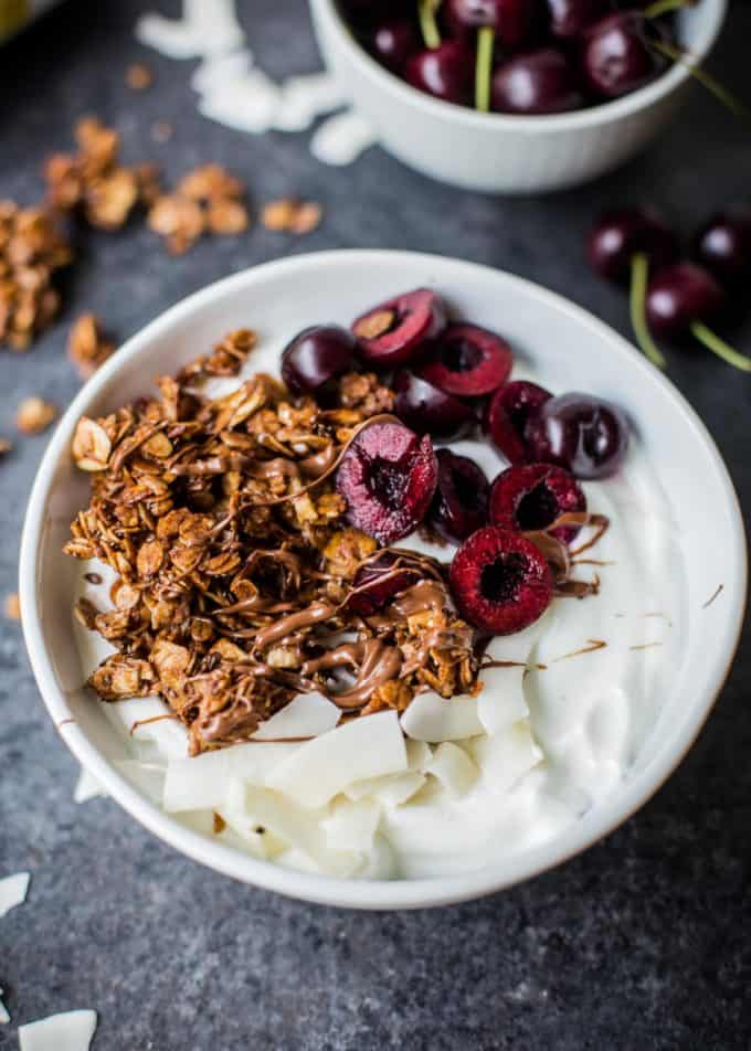 Nutella Granola in a bowl with cherries