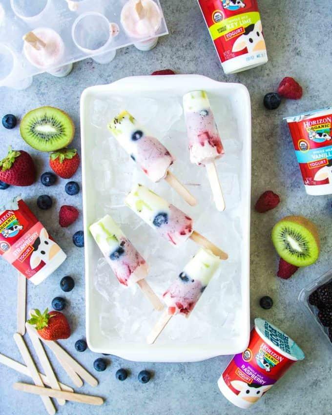 Rainbow Yogurt Popsicles on ice