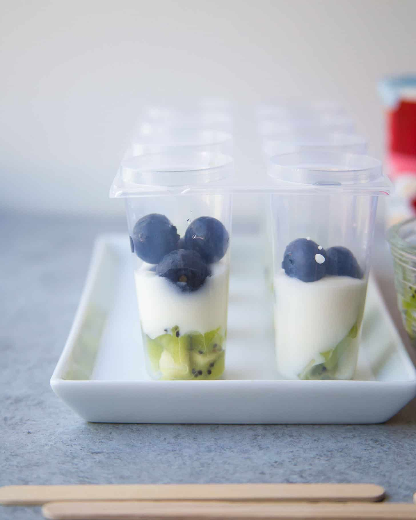 adding fruit to popsicle molds