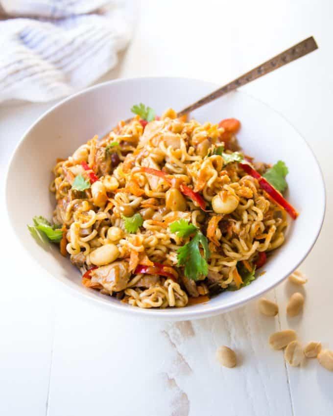 Thai Chicken Peanut Noodles in a white bowl