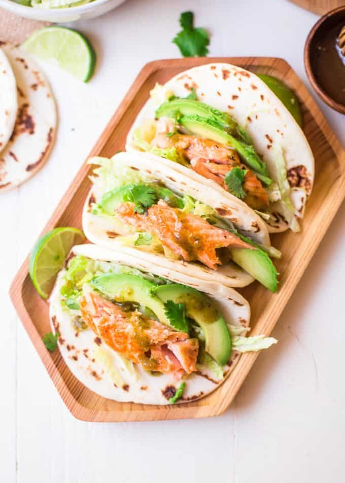 Honey Lime Salmon Tacos on a wooden tray