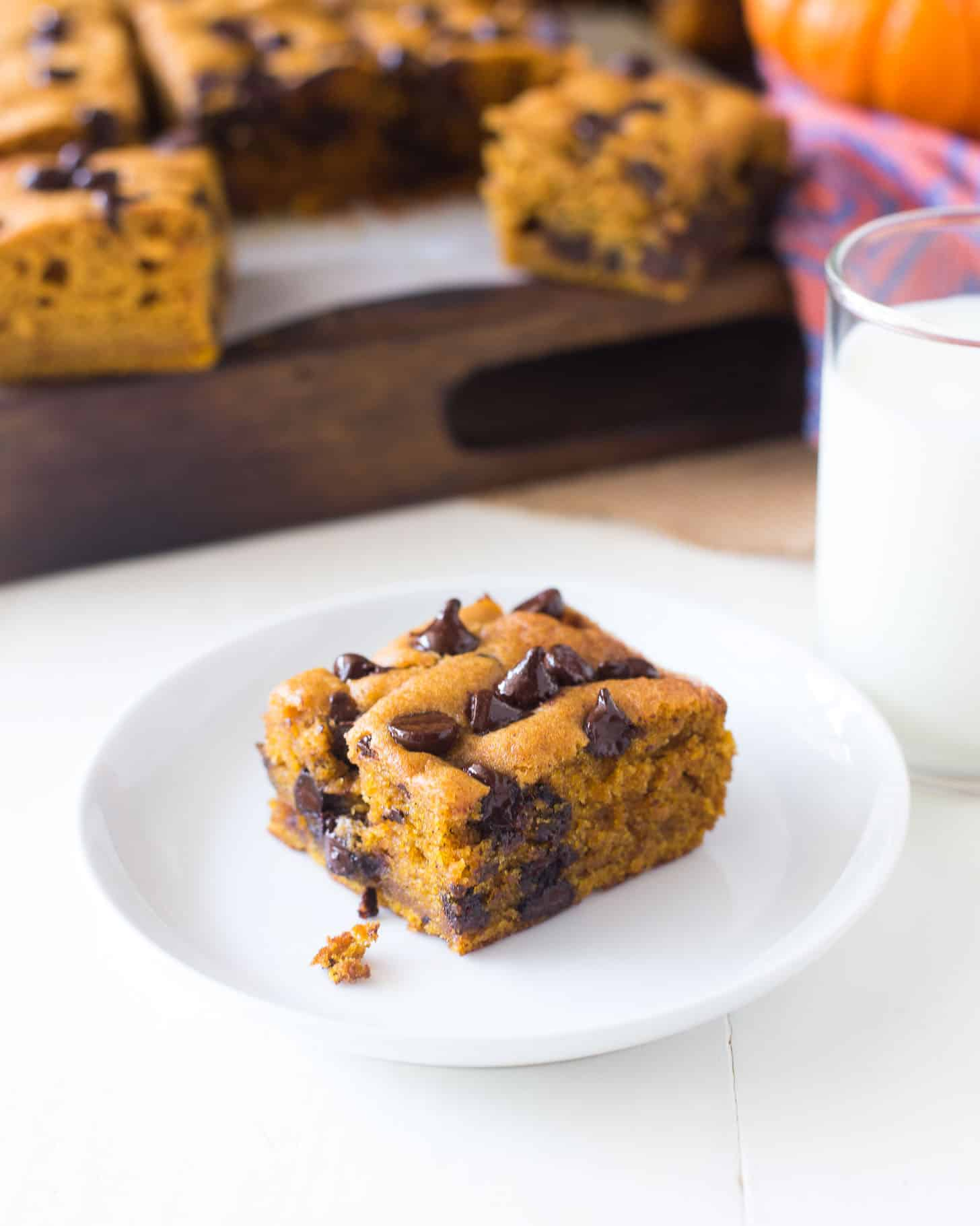 a piece of Pumpkin Chocolate Chip Snack Cake on a white plate