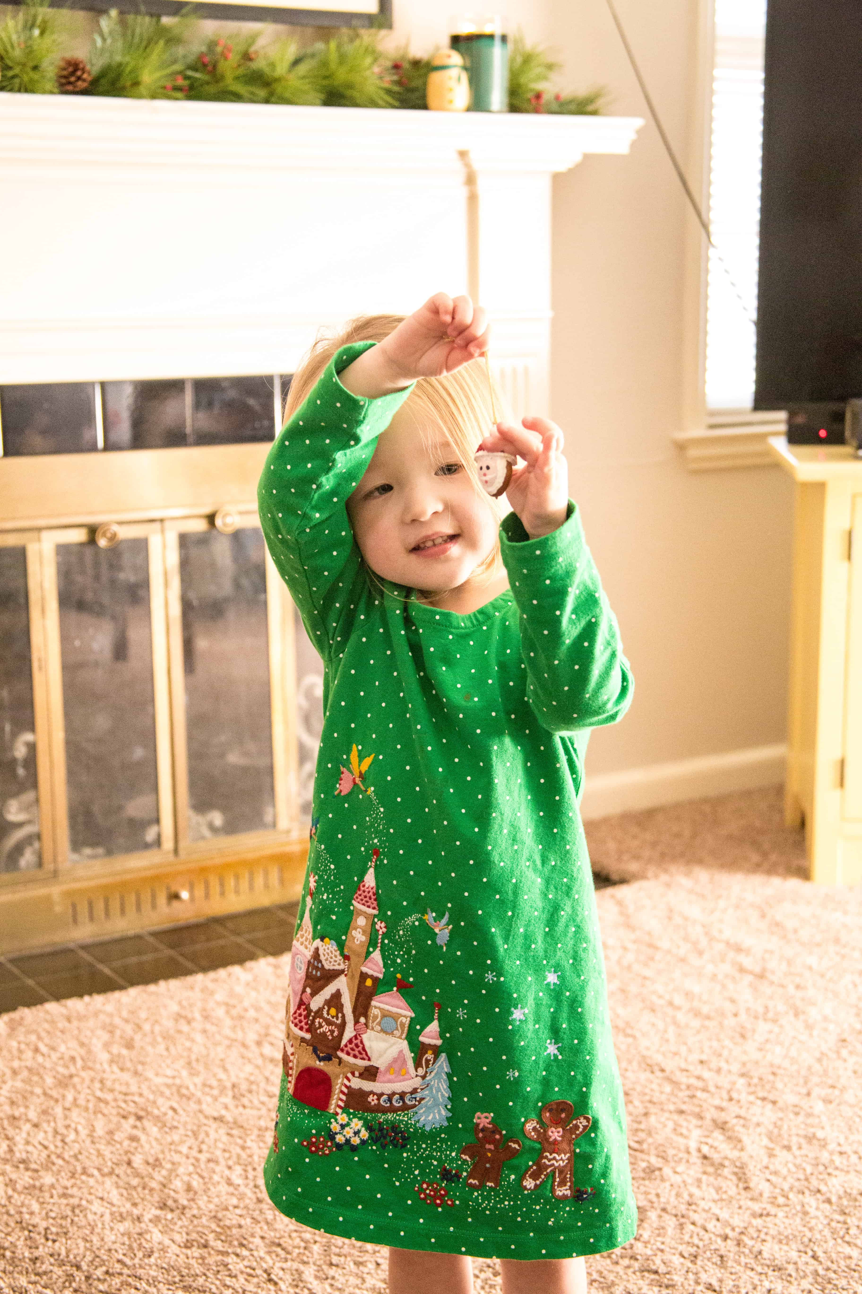 Clara holding a Christmas ornament