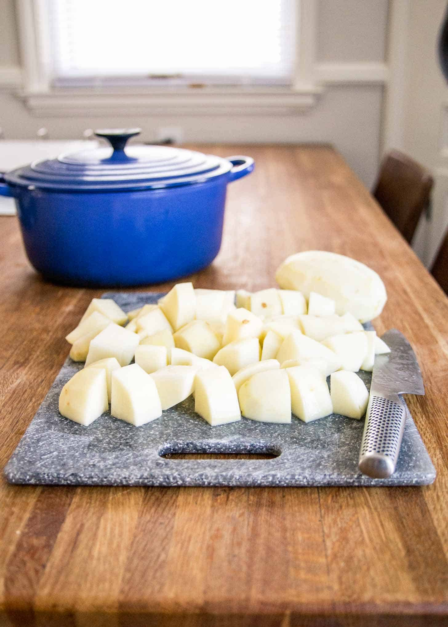 cutting potatoes on a cutting board