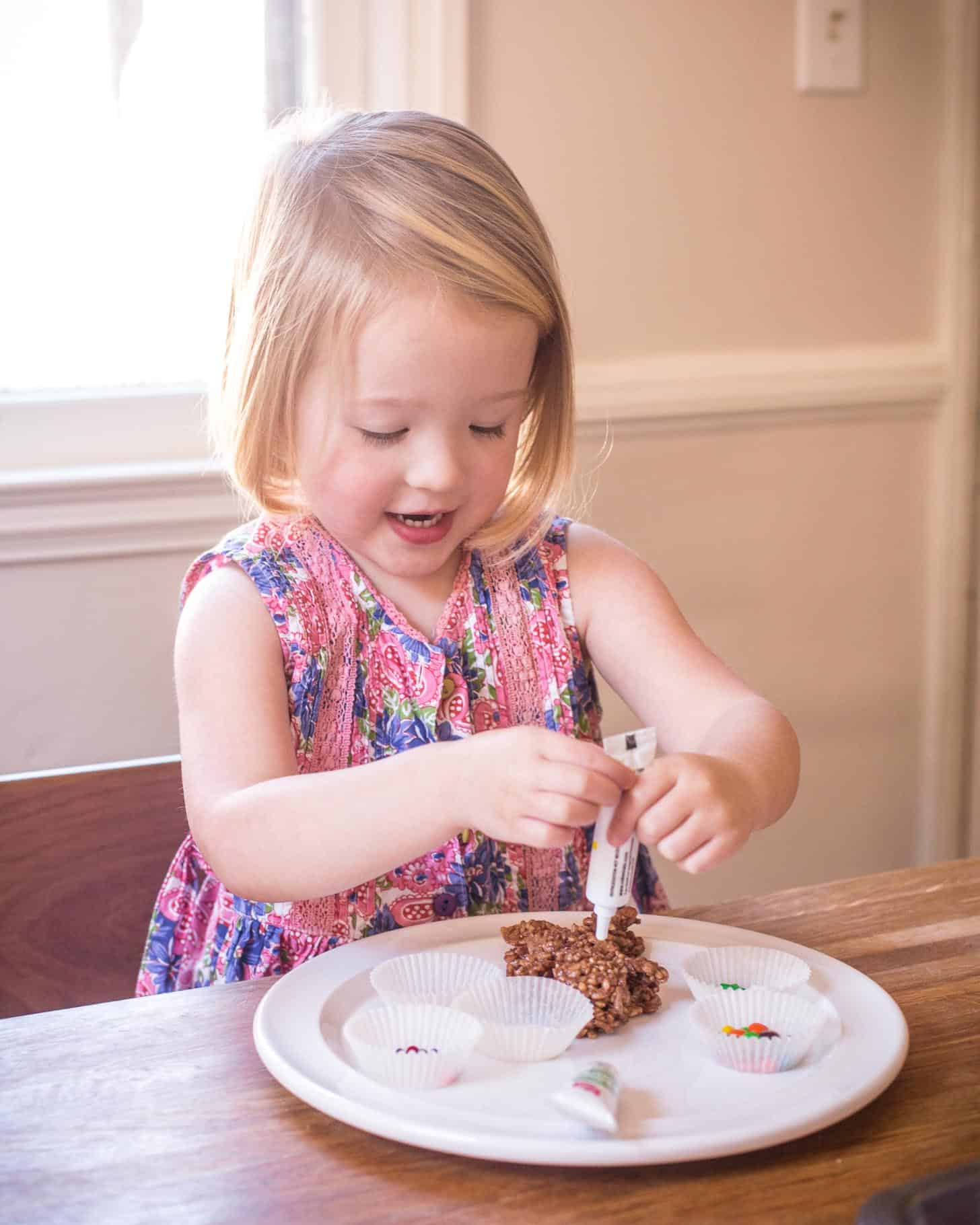 Clara decorating Chocolate Rice Krispies Treats Gingerbread Men