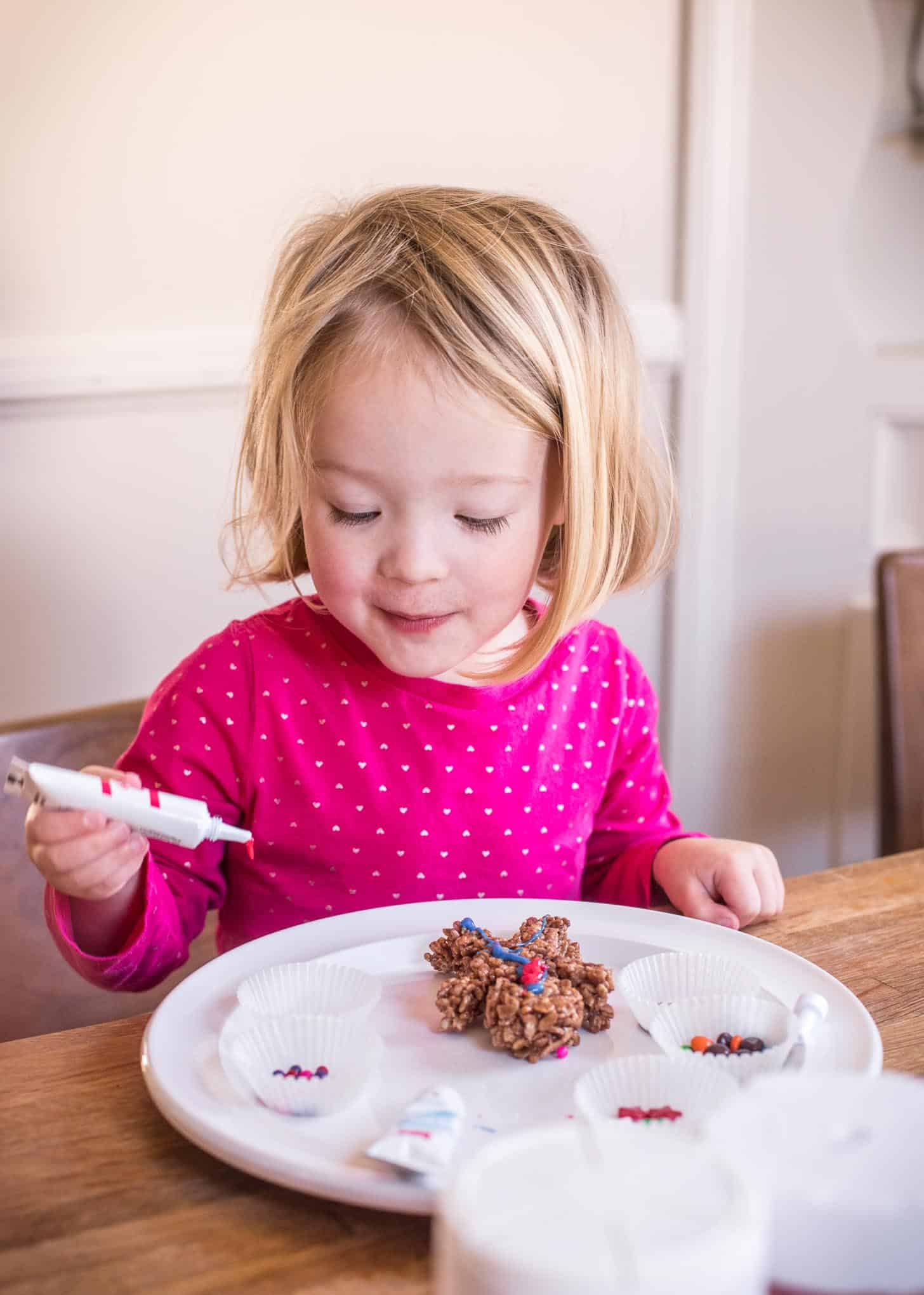 Molly decorating Chocolate Rice Krispies Treats Gingerbread Men