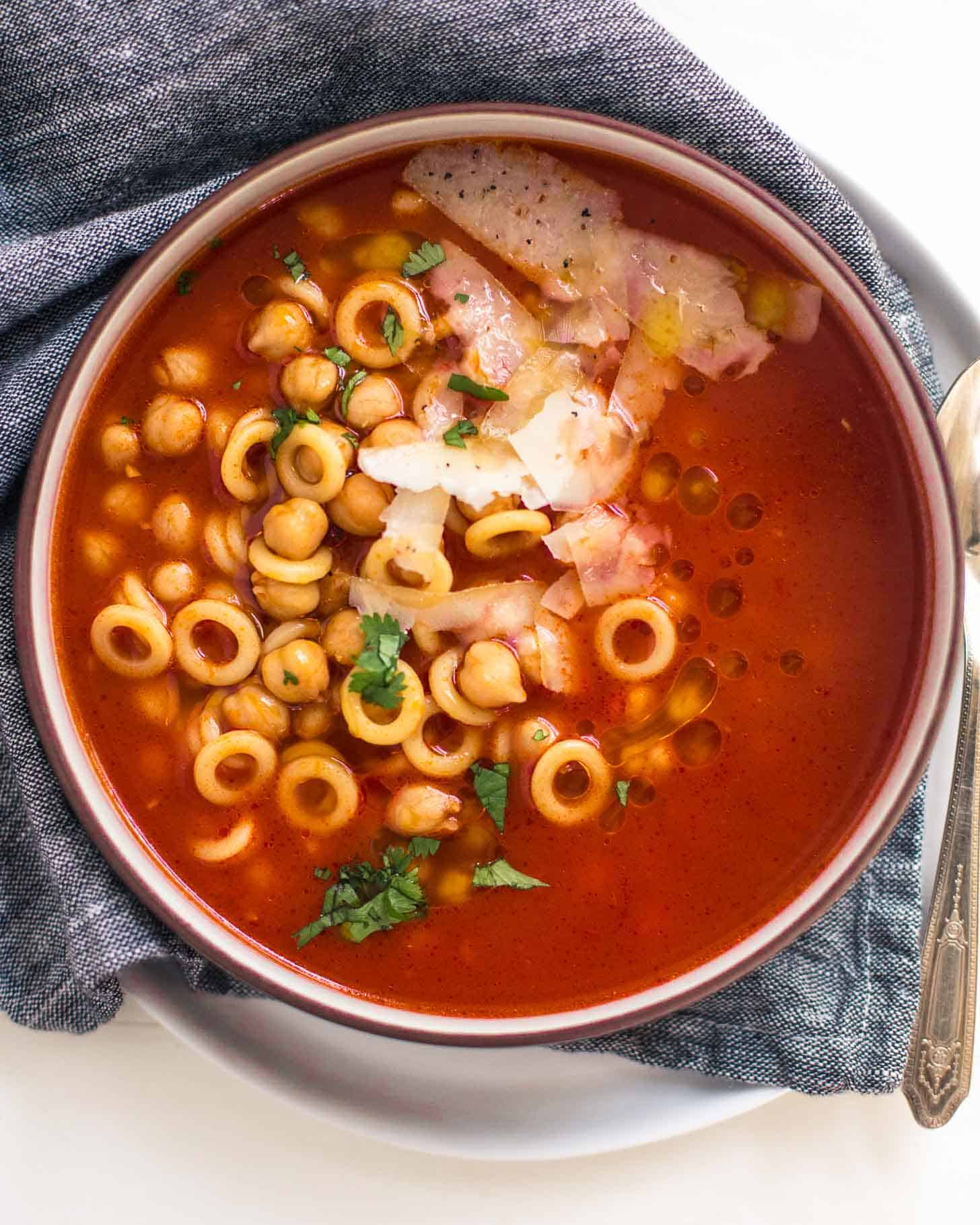 Smoky Tomato Soup with Pasta and Chickpeas in a white bowl
