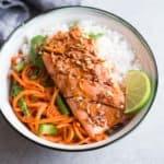 Lemongrass Salmon over rice in a white bowl
