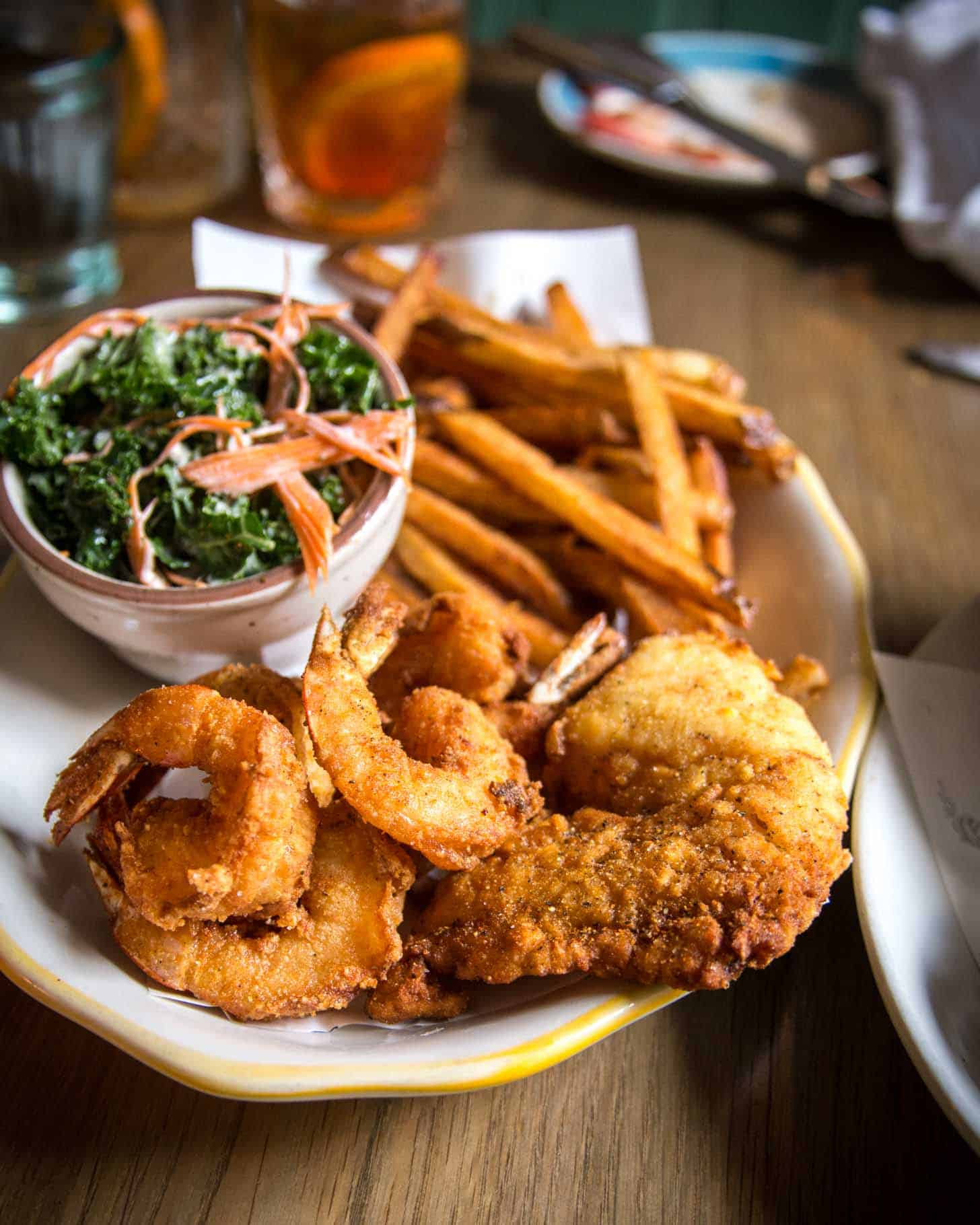 a plate of shrimp and fries
